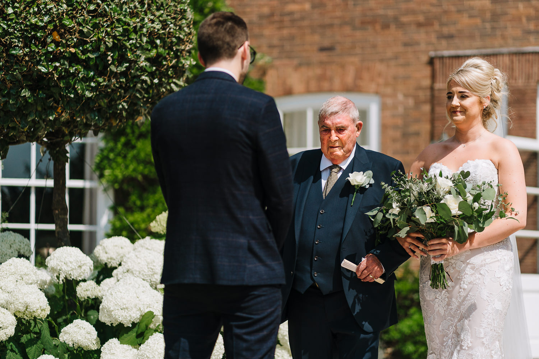 Bride walking down the aisle with grandad