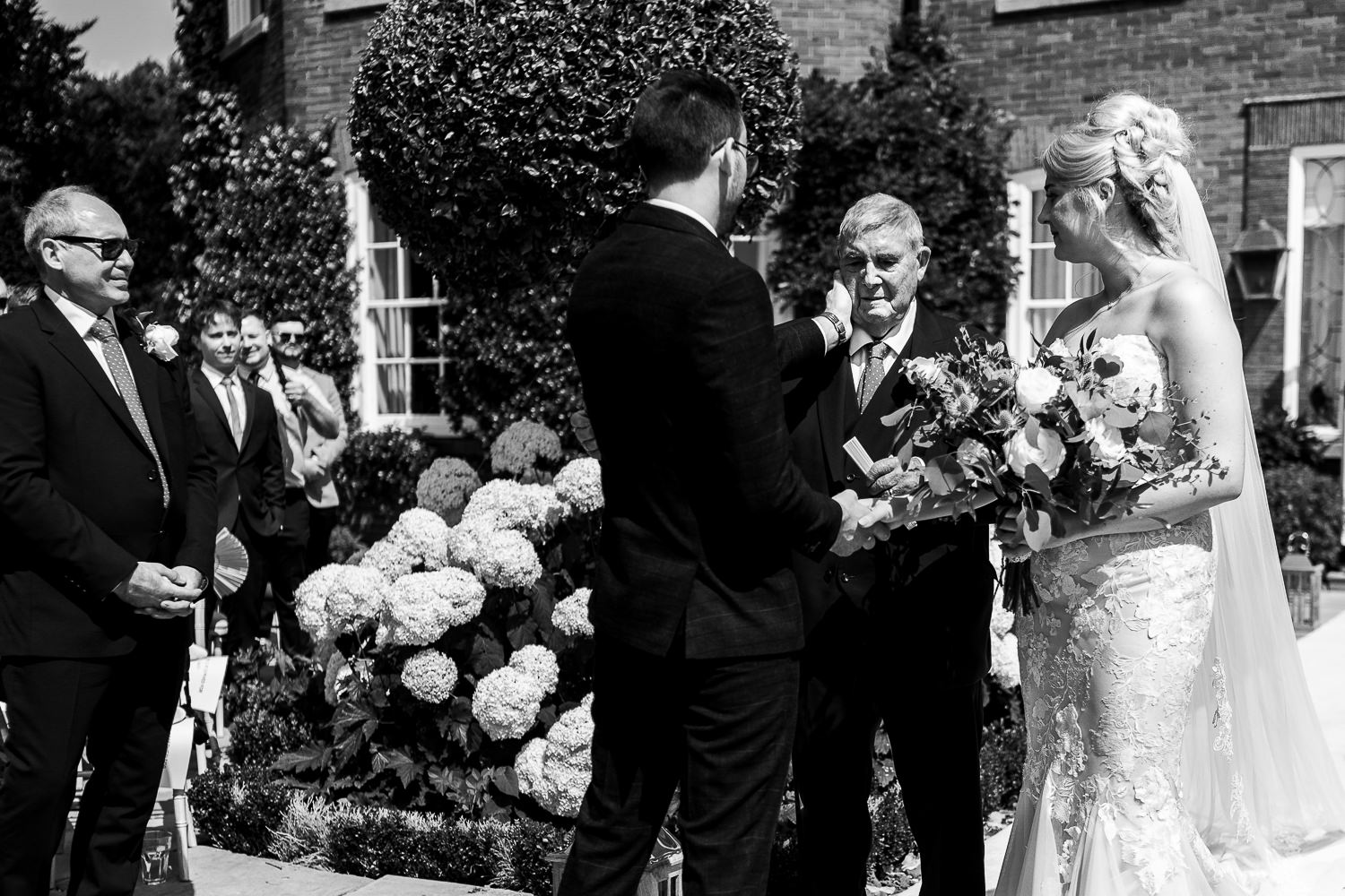 Groom touching grandads face at Delamere Manor