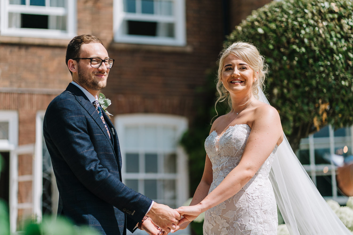 Bride and groom saying vows at Delamere Manor