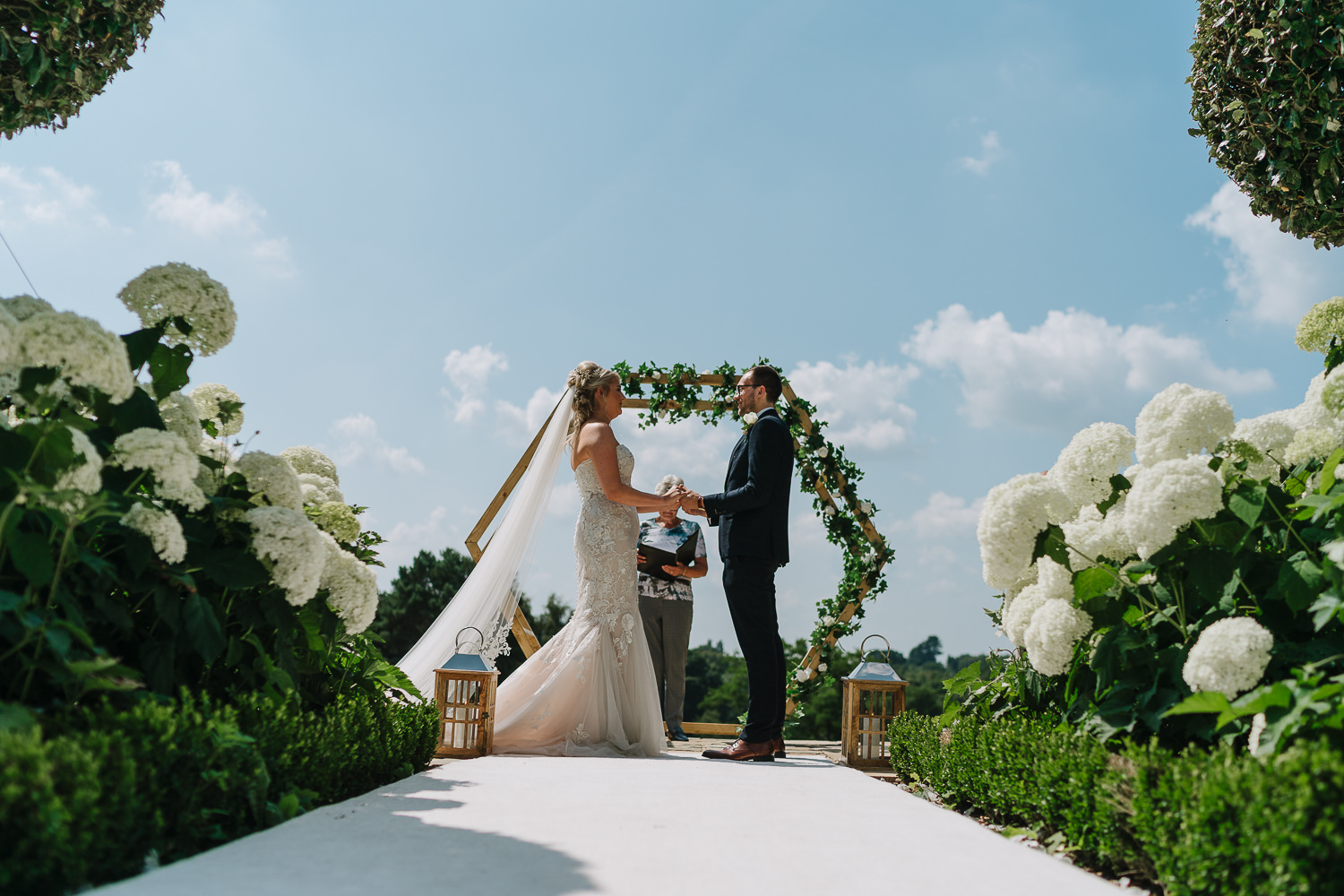 A photo of the bride and groom during the service