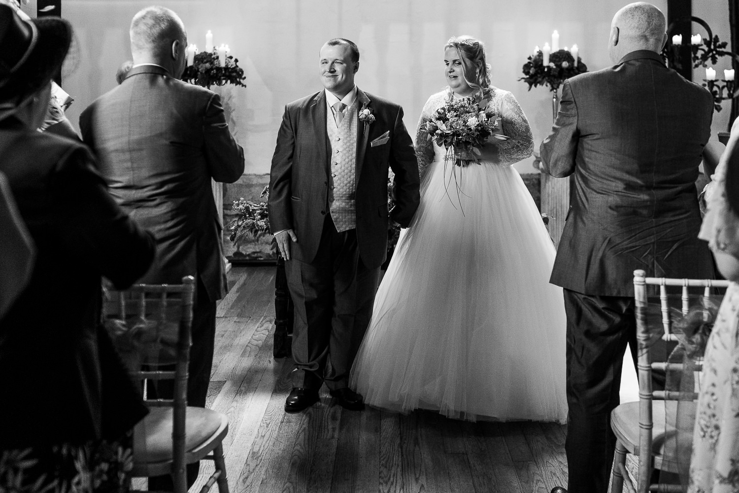 visually impaired bride and groom walking down the aisle at Samlesbury Hall
