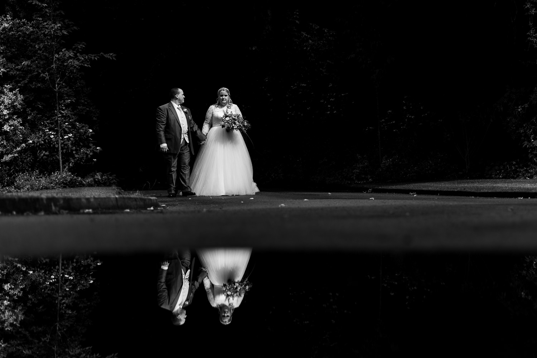bride and groom walking at Samlesbury Hall