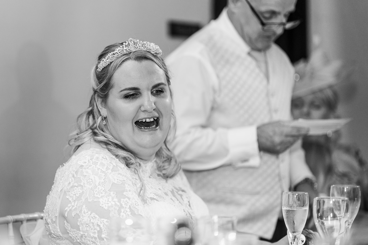 Bride laughing from dads speech
