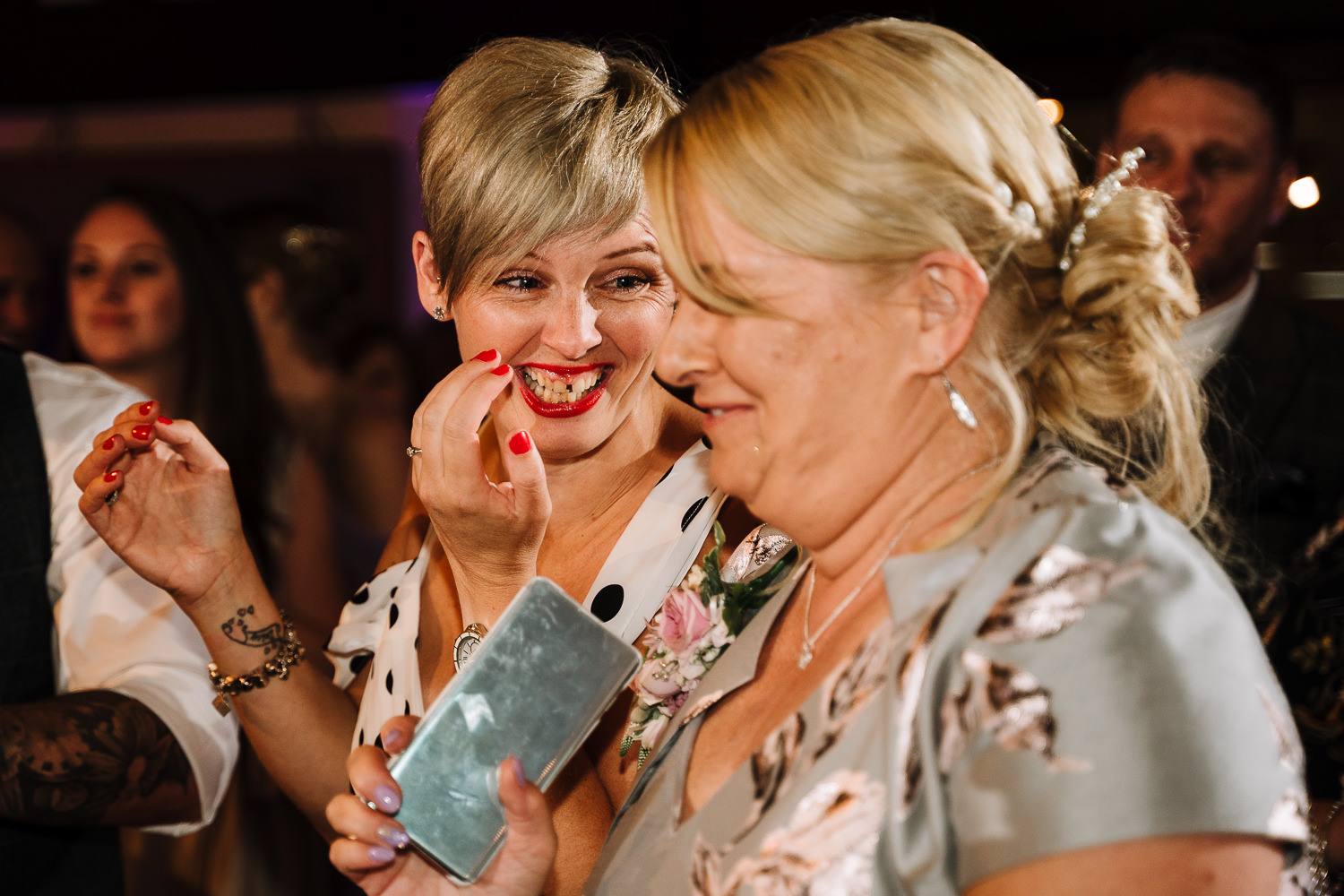 Wedding guests laughing on the dance floor