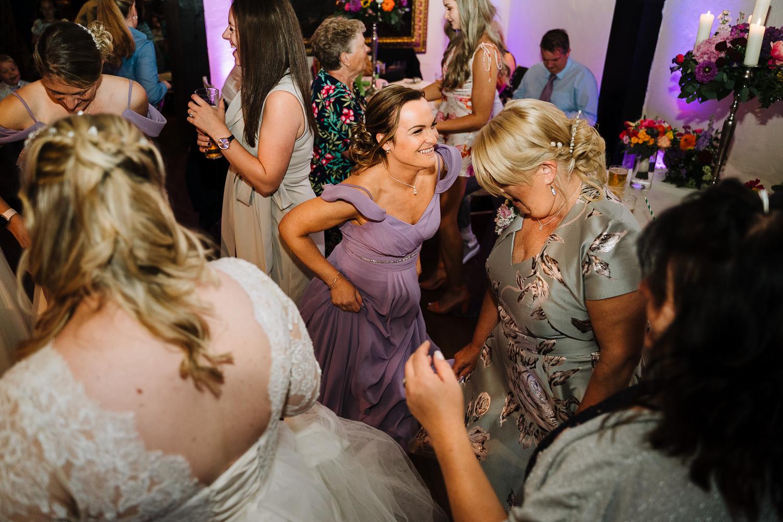 Wedding guests dancing at Samlesbury Hall