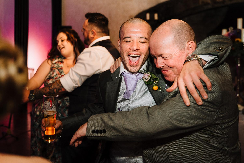 Wedding guests dancing and hugging