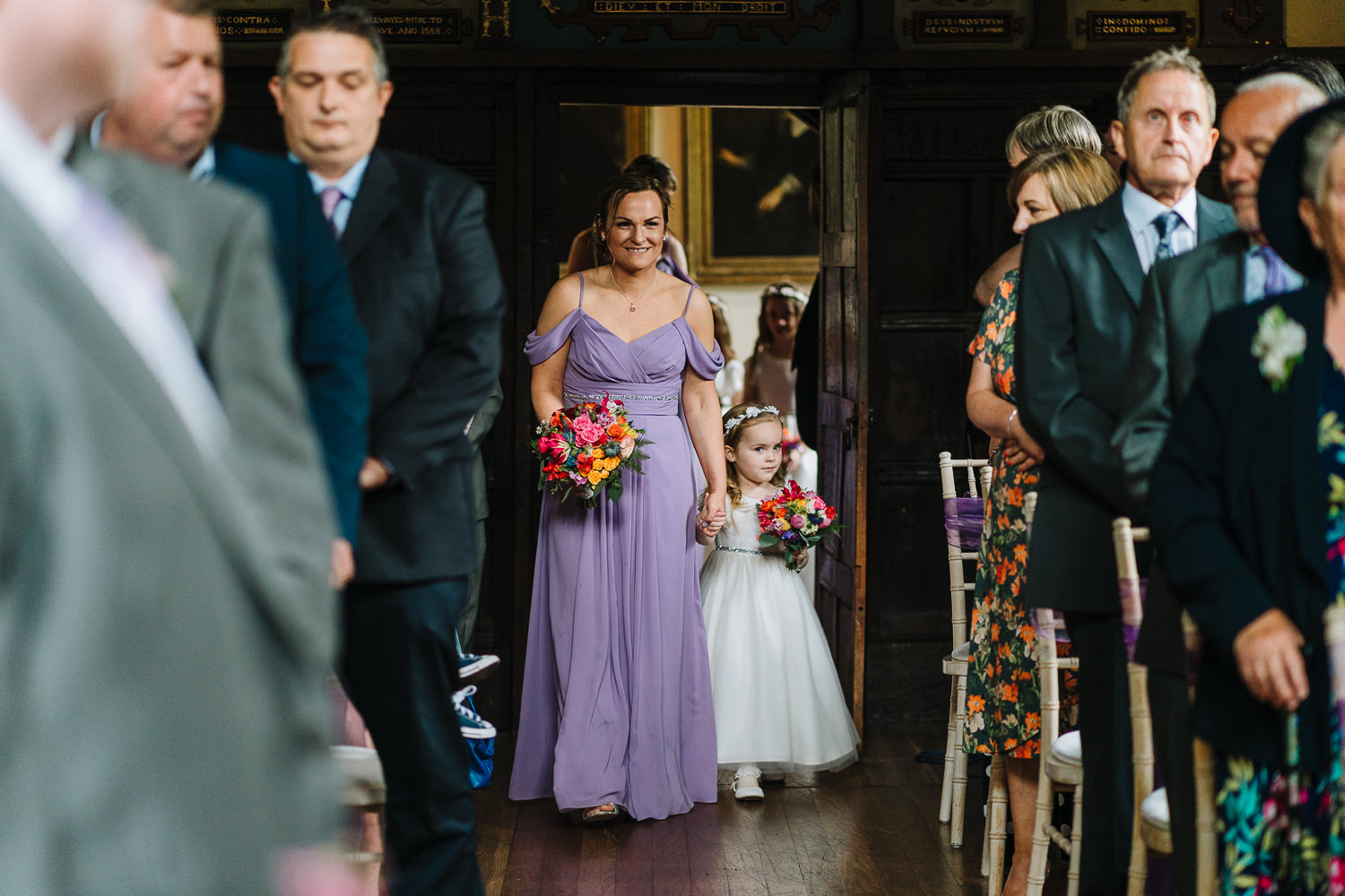 Bridesmaid and flower girl walking down the aisle