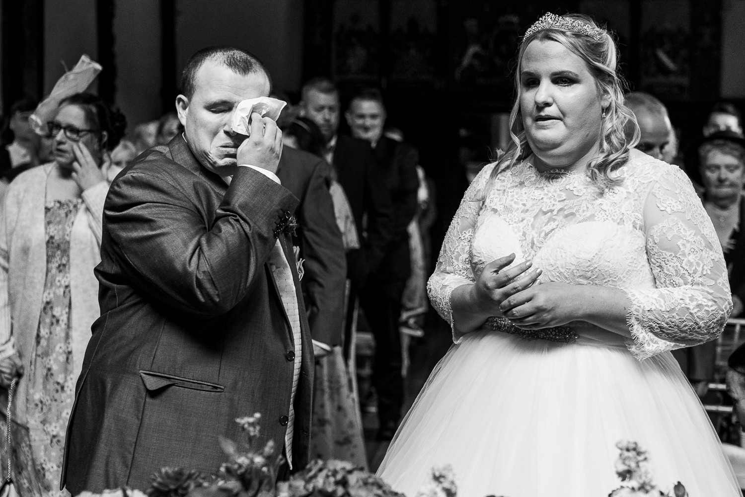 Groom crying with the bride